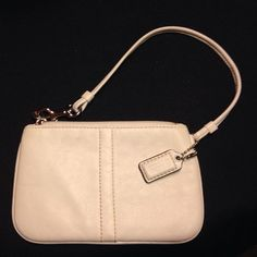 COACH white  leather wristlet/clutch Never used. Received as a gift and most definitely authentic! Has a little spot on the back of the bag (pic 4) that can probably be cleaned with leather cleaner. Lined with baby blue fabric and clean inside... No marks whatsoever. Coach Bags Clutches & Wristlets