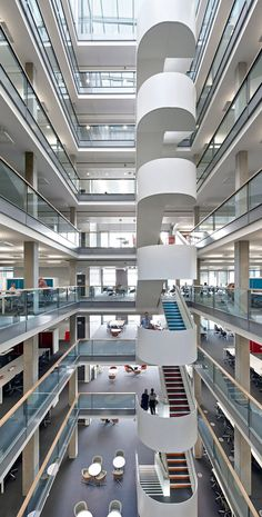 The full-height atrium and central staircase act as a visual focus for the workplace. Photo: Hufton + Crow