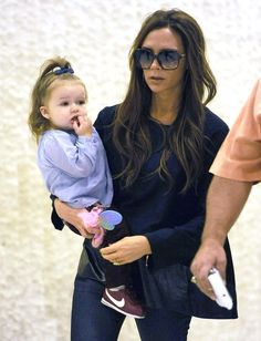 Harper Beckham shows off her airport style as poses with mum Victoria at JFK