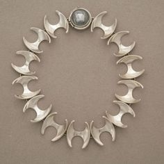Necklace | Designed by Henning Koppel for Georg Jensen |  Sterling silver with hematite cabochon.  Design number 130B.  | ca. 1960s