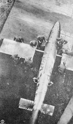 JUN 16 1944 The V1 'doodlebugs' begin hitting London. German personnel fitting the wings to a Fiesler Fi 103 flying bomb at a launching site.