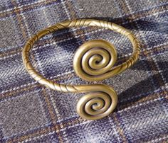 Viking arm ring/ Weird, I made a ring out of copper wire exactly like this as a teenager. -Gwenleif