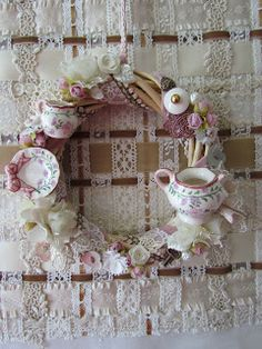 Angela Lace    A small wreath would be great with the pieces from a mini tea set. The large one would be great with thrift store finds, miss matched tea cups, maybe with a silver spoon or two