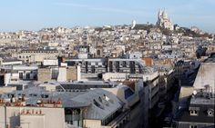 The rooftops of Paris: © REUTERS/Mal Langsdon View of rooftops and the Sacre Coeur Basilica on Montmartre in Paris, November 30, 2011.