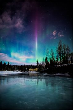Aurora over Elbow River by Christopher Martin on 500px | A purple flame stands out among the Aurora Borealis rippling across the night sky above the Elbow River in Bragg Creek, Alberta, Canada