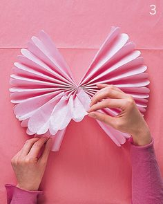 Want to learn how to make tissue paper pom poms for your new nursery? New Arrivals Inc is here to show you how to make DIY tissue pom poms! Tissue Paper Pom Poms Diy, Tissue Paper Flowers, Diy Paper, Paper Crafts, Paper Poms, Tissue Balls, Paper Balls, Hanging Pom Poms, Diy Hanging