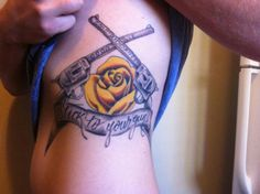 Rib tattoo of revolvers and rose, stick to your guns, pistol, ink