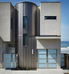 Shown here is 3 Palms, the house of actor Bryan Cranston; it aspires to achieve both LEED Platinum certification and Passive House standards. There's a cylinder in the middle of the main elevation, signaling the entrance and breaking up the facade into smaller volumes.