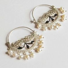 These beautiful earrings are made from sterling silver and pearls