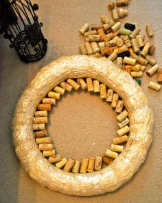 Corks, 14' Straw Wreath, Toothpicks, Hot Glue Gun. Collect lots of corks. Leave the plastic on straw wreath. Put hot glue on one end of a toothpick & insert in cork. Put glue on other end & stick into wreath. Start inside wreath & go around entire circle. Insert each toothpick at an angle- *DON'T stick straight into wreath*. Build outwards making circles of corks until you reach outer edge. Angle all corks in the same direction. It can take 8 layers of circles to reach outer side of wreath.