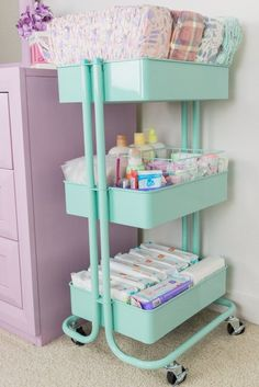 One of my favorite items in my daughter's nursery is the diaper cart. It is a functional and cute way to store some baby essentials, so they are always in reach. Mom brain is real, and having everything in one place means I don't have to look all over trying to remember where I put the little things that my baby needs. It is especially helpful when I'm changing a diaper in the middle of the night or just dealing with a squirmy baby. It is also portable so you can place it wherever you like