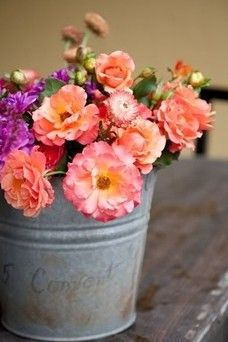 would be a cheap and cute way to put flowers in a tin bucket