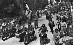 Fighters from the Haganah parade with what would soon be the Israeli flag in 1948