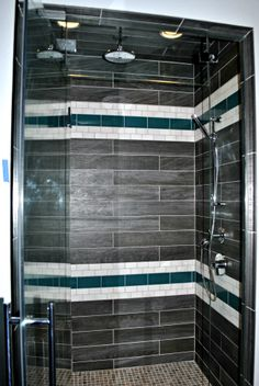 This custom shower has color and dark and light contrasts! Did you see the rock floor?