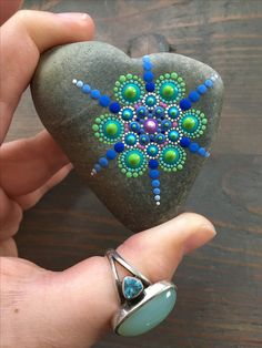 Heart shaped hand painted mandala stone. Dot Art. Dotillism. Dot painting.