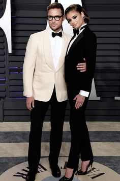 """""""Taylor Hill and Michael Stephen Shank at the Vanity Fair Oscar Party, both wearing Ralph Lauren tuxedos. Night Outfits, Winter Outfits, Outfit Night, Business Chic, Vanity Fair Oscar Party, Taylor Hill, Super Party, Party Fashion, Suits For Women"""