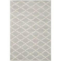 "Stylishly anchor your living room or master suite with this lovely hand-tufted wool rug, showcasing a timeless trellis motif in grey and ivory.  Product: RugConstruction Material: WoolColor: Grey and ivoryFeatures:  Hand-tuftedMade in IndiaPile Height: 0.63"" Note: Please be aware that actual colors may vary from those shown on your screen. Accent rugs may also not show the entire pattern that the corresponding area rugs have.Cleaning and Care: Professional cleaning recommended"