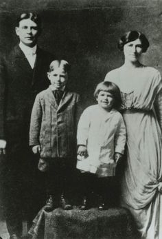 "Ronald Reagan (with ""Dutch"" haircut), brother Neil Reagan, and their parents."