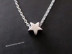 Tiny star pendant necklace in white gold on Etsy, $13.99