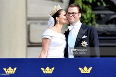 Crown Princess Victoria of Sweden, Duchess of Västergötland, and her husband Prince Daniel, Duke of Västergötland, meet the general public as they appear on the Lejonbacken Terrace after their wedding ceremony on June 19, 2010 in Stockholm, Sweden.