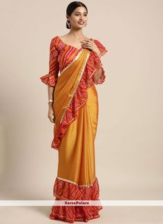 Mustard yellow saree with blouse. Fabric - Two tone faux chiffon (Saree) ; Paired with matching blouse piece. Trendy Sarees, Fancy Sarees, Party Wear Sarees, Chiffon Saree, Saree Dress, Chiffon Fabric, Designer Sarees Collection, Saree Collection, Bandhani Saree