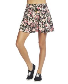 """Super cute floral print in a comfy and stretchy ponte knit body with an elasticized waist band, and a flounce bottom. Skirt is medium weight and has a pull on construction.  Model is 5'9"""" and wears a size small.   97% Polyester / 3% Spandex Hand Wash USA"""
