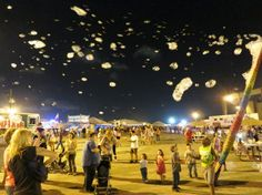 solar powered  BubbleYou® Bubble Tower -the world's biggest bubble toy ® at night!  Pasadena TX Strawberry Festival.