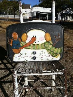 Gingerbread man and snowman on vintage suitcase