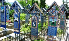 Merry Cemetery, Sapanta, Romania: This cemetery is a unique place because of its very brightly colored gravestones. These wooden headstones commemorate the deceased with a funny saying or by depicting a scene from the occupants' lives. World's Most Beautiful, Most Beautiful Pictures, Beautiful Places, Pet Memorial Jewelry, Visit Romania, Romania Travel, Carpathian Mountains, World Religions, Destinations