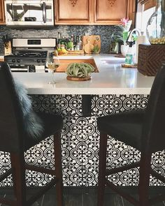 A stenciled kitchen island in black and white using the Augusta Tile Stencil from Cutting Edge Stencils
