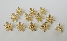 Studs for leather working of Heraldic bees from http://revival.us/heraldicbeestuds.aspx