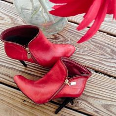 3XHP ℂᎯℛℒᎾЅ ЅᎯℕᏆᎯℕᎯ RED LEATHER BOOTS Sweet & sexy! Carlos Santana red leather booties!  gold zipper! 4 inch heel! Made in Brazil! Pre owned but in great condition! Flaws noted.. Very minor scuffs at the tip of both boots, very minor sole wear! Very minor scuffs on the black part of the heels, insoles are very clean & look new!  no trades! Offers always welcome❤️ Carlos Santana Shoes