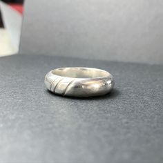 Sherryn made this ring in the Silver Ring Workshop. You get to make whatever you want in these classes, so Sherryn added three lines to her own design. I think it looks great!