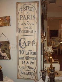 paris sign.  I'd hand paint something like this on the wall