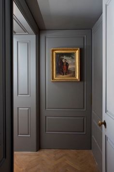 This lone painting is the only embellishment in this subtle gray hallway. A gilded gold frame insures that this work of art is the focal point of this space.