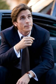 Christian Bale (as Bruce Wayne) in Dark Knight Rises wearing a Jaeger LeCoultre Reverso timepiece.