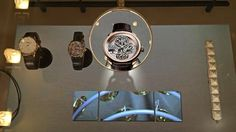 """With the press of a button, a magnifier glides over each piece on display. With """"tracking screen"""" technology, each piece can have it's individual… Magnifier, Interactive Display, Paris, Boutique, Display Case, Luxury, Magnifying Glass, Buttons, Products"""