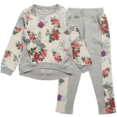 Guess girls grey tracksuit made from soft cotton jersey with gorgeous ivory floral panels with a woven feel. The sweatshirt has two pockets, metallic pink logo lettering on the side and a slightly longer hem at the back, and matching trousers have a wide and comfortable elasticated waist.   100% cotton jersey (comfortable sweatshirt feel) Machine wash (30*C) Two piece set