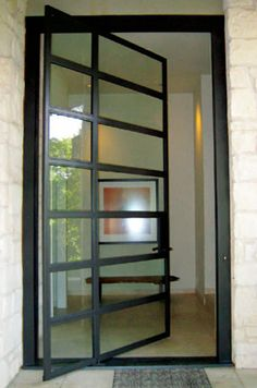 One of the company's most-requested items is oversized steel-and-glass pivot doors, which can be produced in any size or dimension. Artifice recently finished an 11-by-6-foot entry door that opens and pivots off-center. The firm can also plan entire areas.