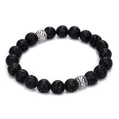 Natural and bold, this charming lava stone bracelet will add a touch of powerful style and grounding energy to your look. The bracelet features a strand of rounded, black lava beads and two silvertone
