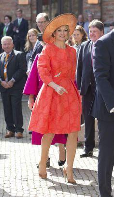 Queen Maxima of the Netherlands makes a colorful entrance in bright orange at the Four Freedoms Awards in Middelburg, Netherlands.