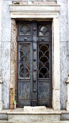 Argentina. Weathered black door.