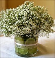 1 – 4 1/2″ wide cylinder glass vase  5 limes  2 bunches of baby's breath