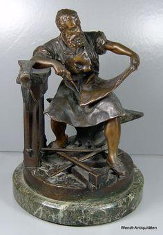Bronzefigur eines Schmiedes - signiert: H.Curadze 1894. Gladenbeck Berlin