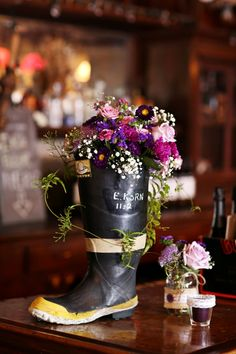 Bar flowers for a fireman's wedding from Seasonal Celebrations. Photo courtesy of Marielle Hayes Photography.