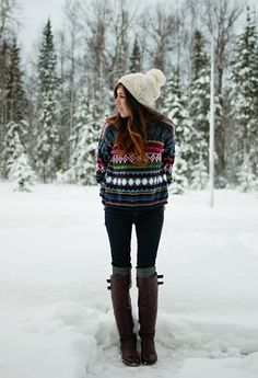 patterned sweater, black skinnies, leg warmers, brown riding boots