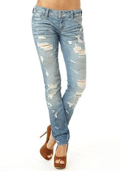 STRETCH five-pocket low-rise skinny with heavy destruction, baked in whiskers and sanding.