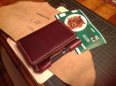Handmade chromexcel leather book cover.  Horween leather with white 1.4mm ritza 25 tiger thread. By SoS Leatherworks.