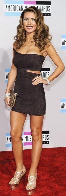 Who made Audrina Patridge's jewelry, gold platform sandals, clutch handbag, and brown dress that she wore in Los Angeles on November 20, 2011? Dress – Joey Tierney with Aurdina Patridge  Shoes and purse – Versace  Jewelry – Kwiat