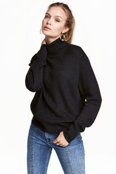 Ribbed polo-neck jumper: Polo-neck jumper in a ribbed viscose blend containing some wool with long raglan sleeves. Loose fit.